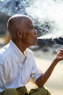 MYA2324 Myanmar, Mrauk U. A man of the Chin people enjoying a smoke, in a small village up river from Mrauk U.