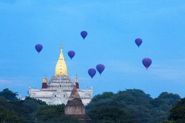MYA2328 Myanmar, Bagan. Hot air balloons over the Ananda Temple at dawn.