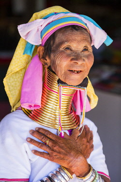 MYA2269 Myanmar, Inle Lake. Padaung lady wearing her heavy brass coiled rings around her neck.