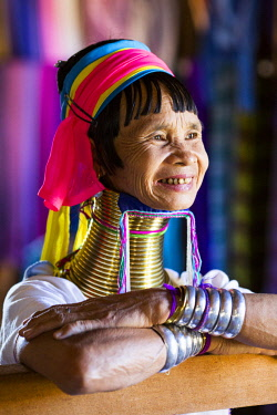 MYA2273 Myanmar, Inle Lake. Padaung lady wearing her heavy brass coiled rings around her neck.