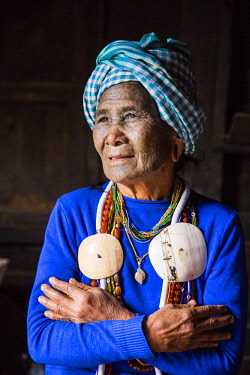 Myanmar, Mindat. A Chin lady with traditional tattoed face.