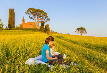 Mom with her daughter relax on Pomelasca meadows, Inverigo, Como province, Brianza, Lombardy, Italy, Europe (MR)