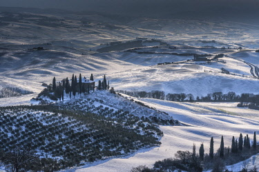 CLKFM93963 hills under the snow, Val d'Orcia, San Quirico, Siena,Tuscany, Italy