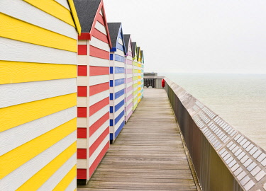 ENG15829AW Beach huts on Hastings Pier, Sussex, England
