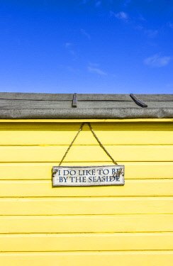 "ENG15844AW ""I do like to be beside the seaside"" traditional beach hut on Littlestone beach, Kent, England"
