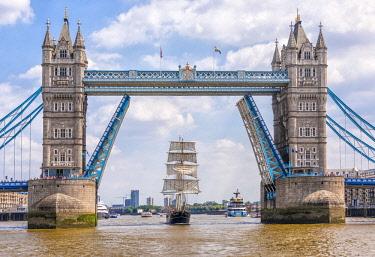 ENG15848AW Tall Ship Thalassa passing through the Tower Bridge, London, England