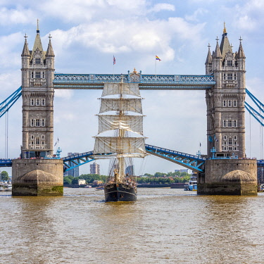 ENG15849AW Tall Ship Thalassa passing through the Tower Bridge, London, England