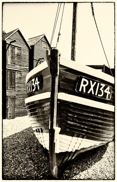 ENG15857AW A fishing boat and the net shops ( a weather-proof storage for the fishing gear), Hasting Old Town, Sussex, England