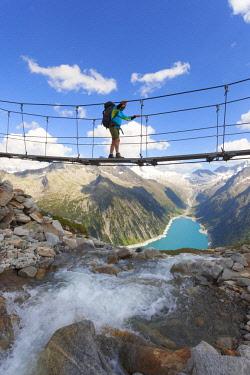 CLKDC94337 The tibetan bridge near Olperer refuge with Lake Schlegeispeicher on the background, Zillertal Alps, Tyrol, Schwaz district, Austria. (MR)