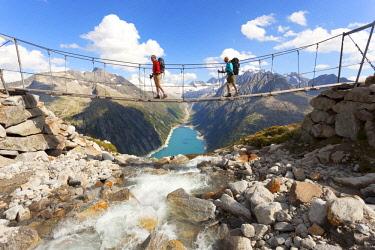 CLKDC94341 The tibetan bridge near Olperer refuge with Lake Schlegeispeicher on the background, Zillertal Alps, Tyrol, Schwaz district, Austria. (MR)