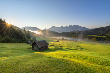 Gerold Lake, Krün, Garmisch-Partenkirchen district, Upper Bavaria, Bavaria, Germany, Europe. Sunrise at Gerold Lake with the Karwendel Alps in the background