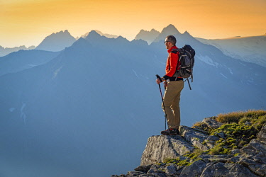 CLKSS93439 Hiker in Peterskopfl at sunrise Europe, Austria, Zillertal, Peterskopfl, Keisergebirge (MR)