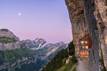 CLKRM94015 Aescher-Wildkirchli Gasthaus at dusk, Ebenalp, Appenzell Innerrhoden, Switzerland
