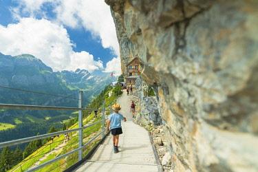 CLKRM94026 Child on walkway to Aescher-Wildkirchli Gasthaus, Ebenalp, Appenzell Innerrhoden, Switzerland