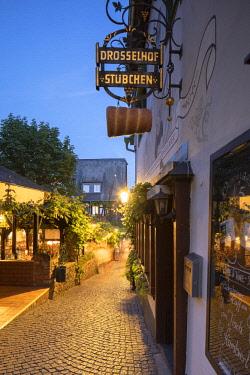 GER11088AW Drosselgasse Street at dusk, Rudesheim, Rhineland-Palatinate, Germany