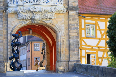 GER11303AW Man walking under Altes Rathaus (Old Town Hall), Bamberg (UNESCO World Heritage Site), Bavaria, Germany