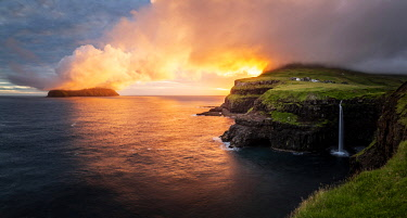 DEN0392AWRF Gasadalur waterfall at sunset, Vagar, Faroe Islands