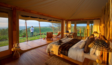 KEN11280 Loisaba Tented Camp, Elewana Collection, Laikipia, Kenya, luxurious, spacious bedroom with spectacular view
