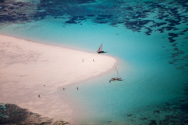 KEN11379 Kenya, Diani, Diani Beach, AfroChic, aerial view of dhows and beautiful turquoise water.
