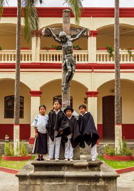 ECU1480AW Native kids in Jordan Convent Cloister, Otavalo, Imbabura Province, Ecuador