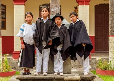 ECU1481AW Native kids in Jordan Convent Cloister, Otavalo, Imbabura Province, Ecuador