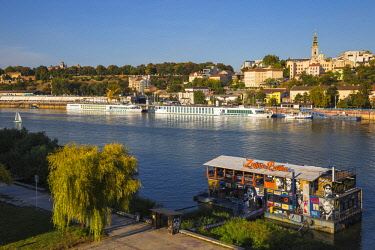 SB01146 Serbia, Belgrade, Floating bar and nightclub on Sava River across to St.Michael's Cathedral in the historical center