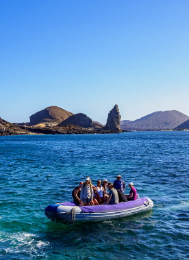 GAL0218AW Dinghy with tourists arriving at the Bartolome Island, Galapagos, Ecuador
