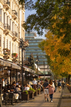 HUN1672AW People walking past outdoor restaurants along Danube Promenade, Budapest, Hungary
