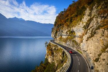 CH02532 Bending road by lake Thun, Berner Oberland, Switzerland