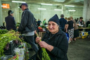 GG01290 Georgia, Kutaisi, Kutaisi Market, produce vendor