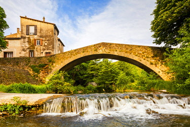 FRA10801 France, Occitanie, Lodeve.The 12 th Century Roman Bridge in the historic centre of Lodeve.