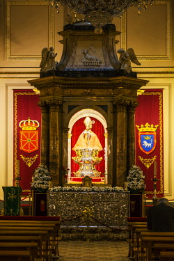 SPA8576 Spain, Navarre, Pamplona. The famed statue of San Fermin inside the church of St Lawrence.