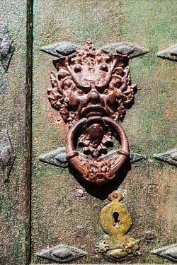 SPA8597 Spain, Navarre, Cirauqui. Door knocker in the hamlet of Cirauqui on the Camino Frances just after Puenta La Reina where the several routes meet to continue towards Santaigo de Compostela towards the v...