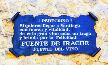 SPA8600 Spain, Navarre, Ayegui. Apilgrim sign for the Bodegas Irache with is Feunte del Vino. It is customary on the Camino routes especially the Camino Frances to have fountains of water. The Irache fountain...