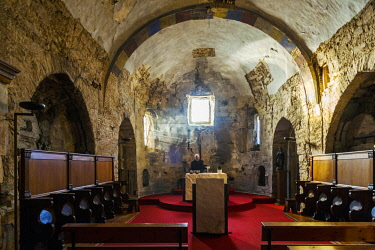 SPA8605 Spain, Castilla y Leon, Rabanal del Camino. A benedictine monk in the Church of the Benedictine Monastery San Salvador del Monte Irago which follows the strict tradition of St Benedict with morning pr...