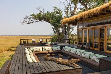 ZAM8154 Zambia, Kafue National Park, Busanga Plains.  The open deck of the attractive Shumba Camp overlooking Busanga Plains.