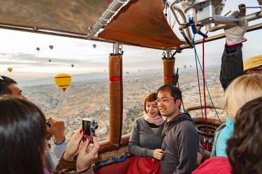 TUR1053 Turkey, Cappadocia, Goreme, Watching Hotair ballooning at dawn