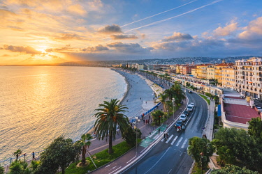 FRA10917AW France, Provence-Alpes-Cote d'Azur, French Riviera, Alpes-Maritimes, Nice. The Promenade des Anglais at sunset.