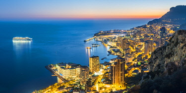 FRA10997AW France, Provence-Alpes-Cote d'Azur, French Riviera, Alpes-Maritimes, Principality of Monaco. Monaco skyline at dusk.