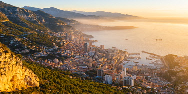 FRA11004AW France, Provence-Alpes-Cote d'Azur, French Riviera, Alpes-Maritimes, Principality of Monaco. Monaco skyline at sunrise from the Tete de Chien.