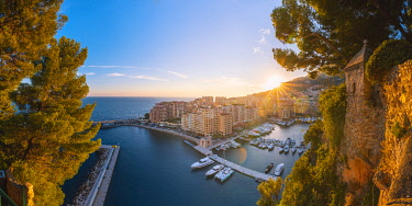 FRA11007AW France, Provence-Alpes-Cote d'Azur, French Riviera, Alpes-Maritimes, Principality of Monaco. Fontvieille harbour at sunset.