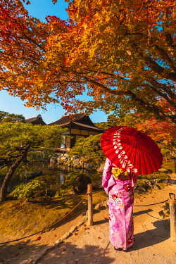 JAP1488AW Ginkaku-ji (Jisho-Ji) temple, Kyoto, Kyoto prefecture, Kansai region, Japan. Woman in kimono admiring the temple's japanese garden (MR).
