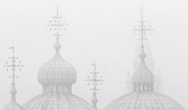 ITA13412AW Silhouettes of St. Mark's Cathedral and Campanile San Giorgio Maggiore in the fog, Venice, Veneto, Italy.