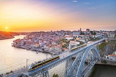 POR10092AWRF Porto at sunset with two trains on Louis I bridge on Douro River. Oporto city, Porto district, Portugal, Europe