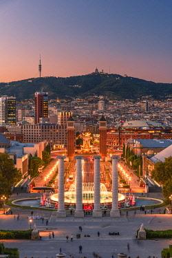 SPA8668AW City skyline with Montjuic fountain at dusk, Barcelona, Catalonia, Spain