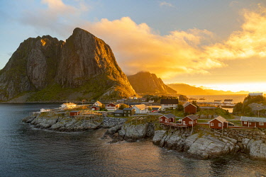 NW03449 Red wooden huts, known as Rorbu, in the village of Reine on the Hamnoy island, Lofoten Islands, Norway. Rorbu is a Norwegian traditional house used by fishermen, today most are used by tourists