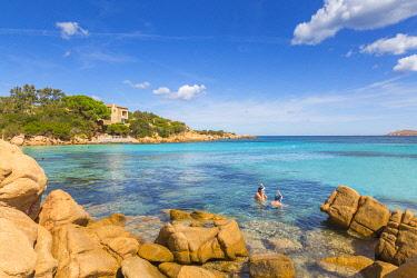 CLKAB68782 Couple of tourists snorkel in crystal turquoise water in Capriccioli beach, Arzachena Costa Smeralda, Olbia-Tempio province, Sardinia, Italy