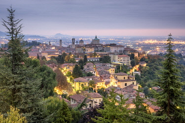 CLKAB97378 Cloudy sunrise at upper city of Bergamo, Lombardy, Italy