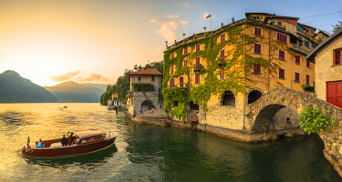 CLKFB94331 A boat of tourists stops to observe the sunset. Nesso, Province of Como,  Como Lake, Lombardy, Italy, Europe.