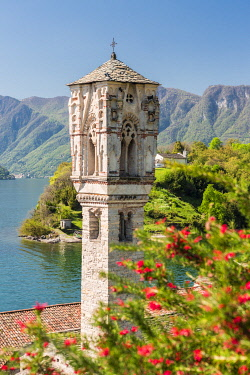 CLKGA94809 Gothic bell tower of S. Mary Magdalene church in Ospedaletto and Isola Comacina in the background, Ossuccio, Como province, Lombardy, Italy